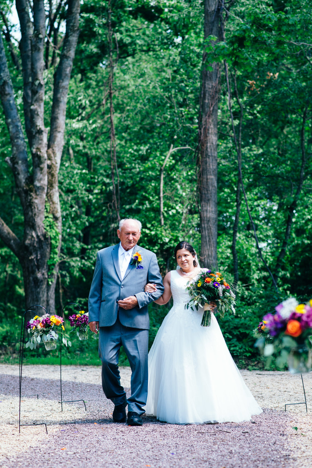 Bride walked down the aisle by her grandfather at The Farm on the Ridge in Hooversville, PA