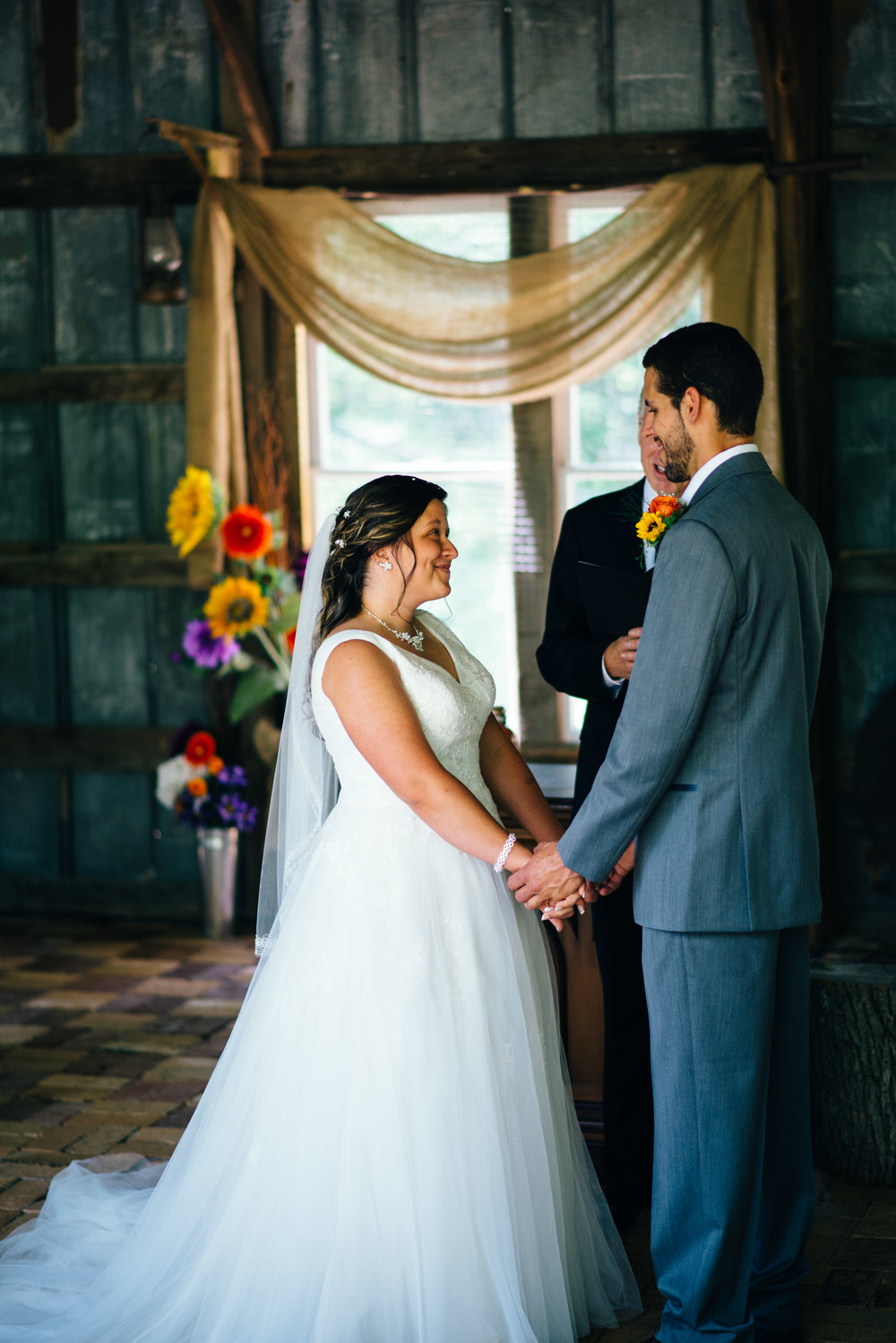 Bride and groom exchanging vows at The Farm on the Ridge in Hooversville PA