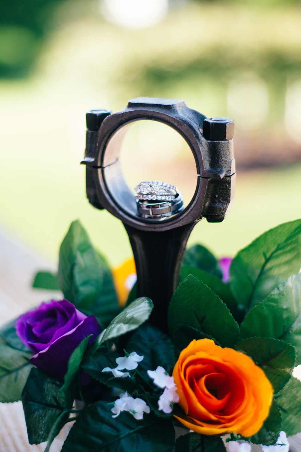 DIY car themed wedding centerpiece piston with wedding rings