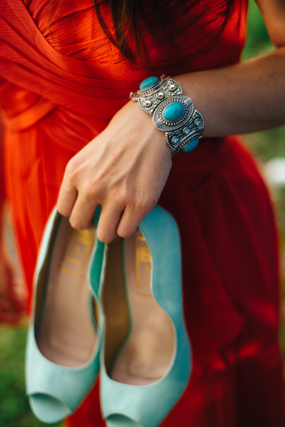 Bridesmaid in orange dress with mint green peep toe pumps and turquoise accent jewelry