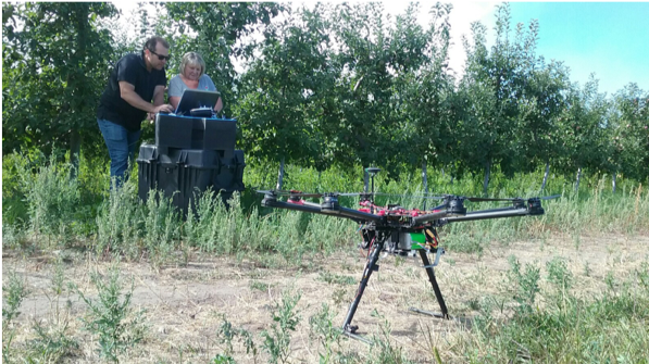 Dustin Krompetz demonstrating the UAS to a stakeholder