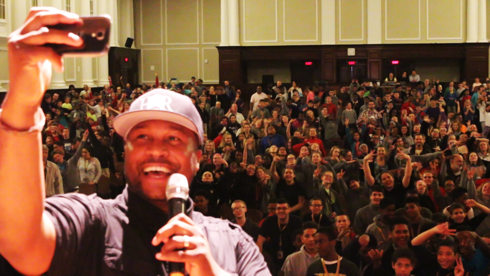 ABOVE : Founder of HoodRISE Global Inc. and Lead Creative Artist for HoodRISE Music; Dr. Nashon Walker, taking a selfie on stage with the students of Milton Hershey School, in Hershey, Pennsylvania.