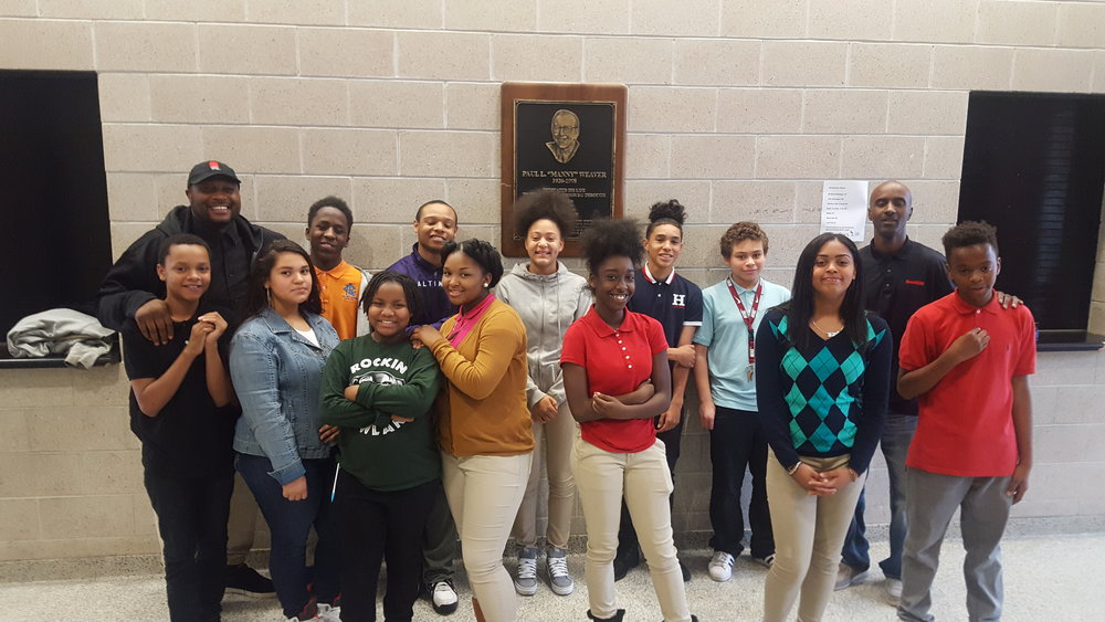 Founder and CEO of HoodRISE Global Inc.; Dr. Nashon Walker and Vice President of HoodRISE Global Inc.; Dr. Gerald Jarmon, joined by the many HoodRISE Academy Award recipients, at Rowland Academy, in Harrisburg, PA.  FRONT: Eugene Sawyers (7th grader), Arixamar Novoa (7th grader), Heaven-Leigh Hairston (7th grader), Money Williams (7th grader), Sahliyah McGill (8th grader), Hilary Pena (7th grader), and Mylik Young (6th grader). BACK: Dr. Nashon Walker (Founder and CEO of HoodRISE Global Inc.), Shamar McCollum (6th grader), Sheldon Ripply (7th grader), Jalasia Hull (8th grader), Carlos Tirado (8th grader), Joseph Rivera (7th grader), Dr. Gerald Jarmon (VP of HoodRISE Global Inc.).