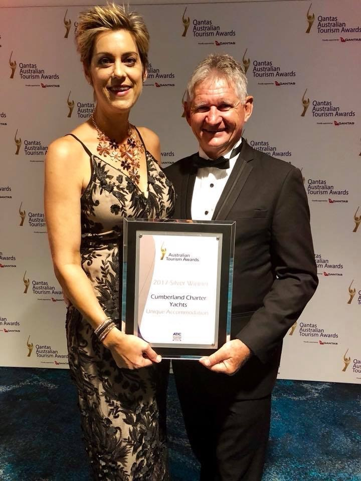 General Manager Sharon McNally and Managing Director Charlie Preen accepting the silver award for Unique Accommodation at the Qantas Australian Tourism Awards at the Perth Optus Stadium on Friday evening.