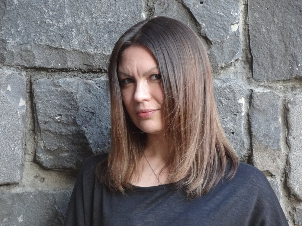 Katya de Becerra - author of What the Woods Keep, out September 18, 2018Author, I Never is a segment in which I interview fellow authors about the writing process, breaking into the industry, and breaking rules. I ask some hopefully novel questions along with some of the old standards, and finish it up with a round of I Never to find out what cardinal writing rules we've broken.