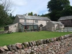 Church House, Eskdale - A seven person Lakeland farmhouse set in two acres of gardens, meadows and babbling brooks all set against the vista of the high fells.