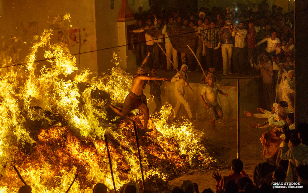 Mind over matter: year after year, the priest keeps this extremely dangerous ritual alive