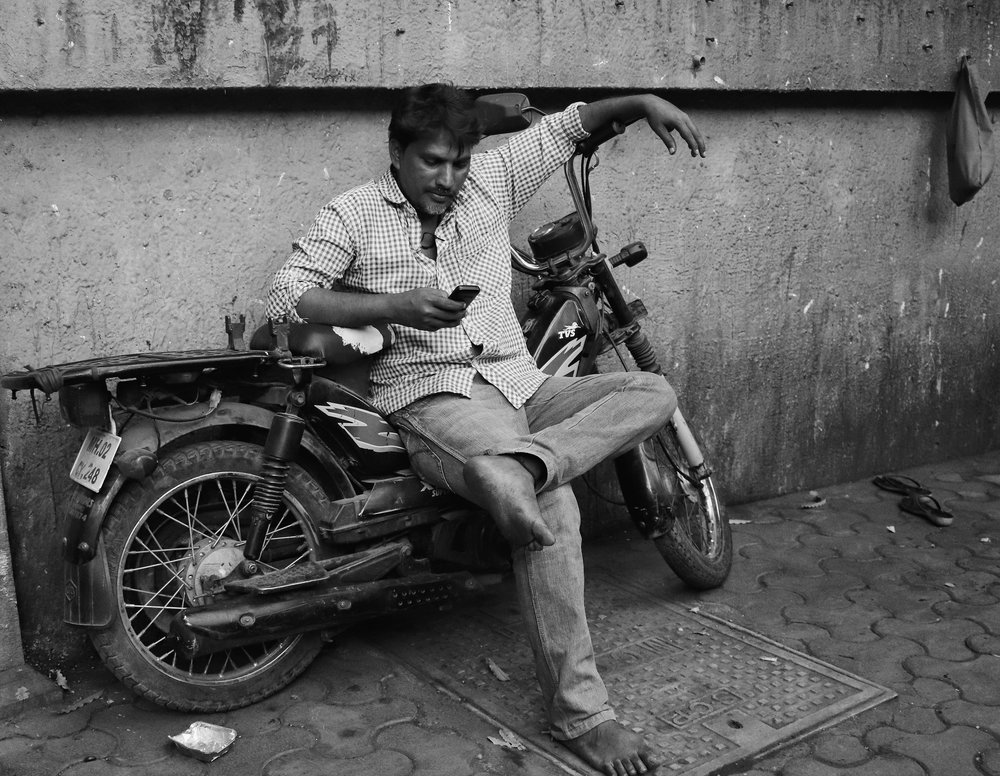 As I turned left from the bus stop, I saw this man seated on an old bike. These single-seat bikes aren't available anymore. Or at least, they aren't popular like they used to be. My uncle had one when I was little. You had to kick-start it till your feet bled before you could work up some life into this fickle thing.