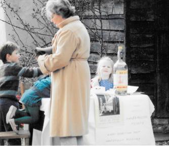 Margaret with her grandchildren manning a stall