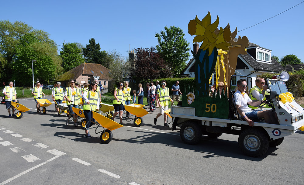 The Daffodil Weekend Committee and their Yellow Barrows (Thriplow version of Red Arrows)
