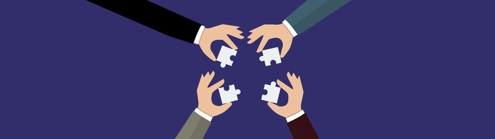 Hands putting puzzle pieces together. Copyright:  siraanamwong / 123RF Stock Photo