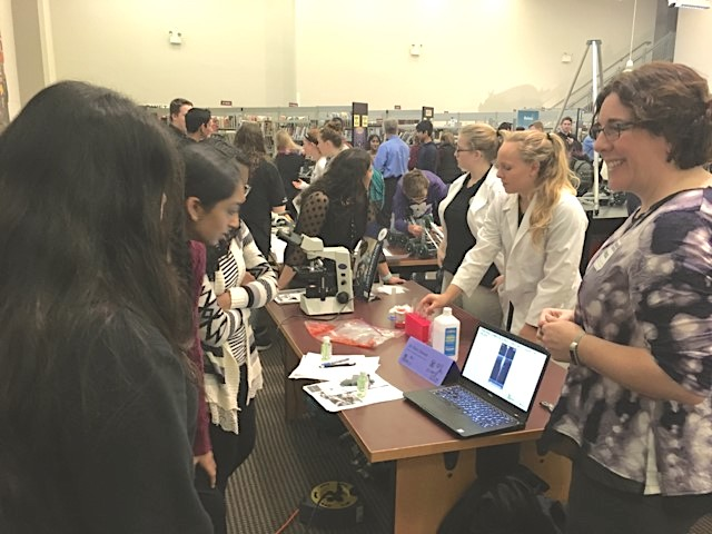"Mary Stewart (right), Director of Education & Workforce Development at ARMI  | BioFabUSA, engages with students at ""Girls in STEM"""