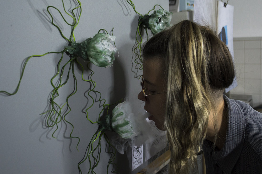 """Visitor exposing """"Audible flora"""" to pollution, making it scream."""