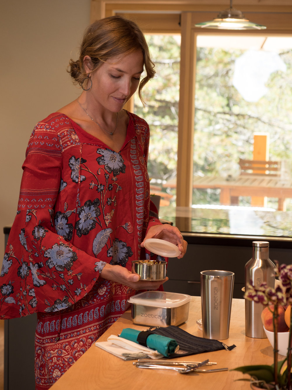 Preparation matters! Elizabeth, a busy single working mom, gathering and organizing her Nomad Kit for a work trip.