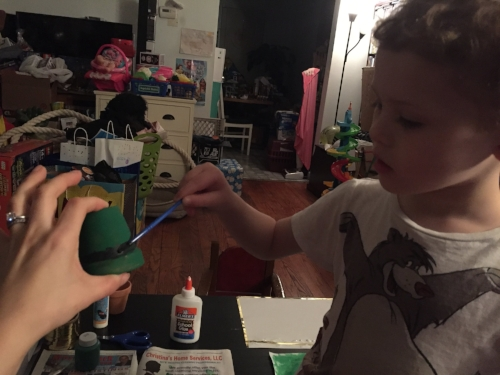 Painting black band on leprechaun hat craft