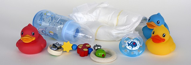 Baby toys, diaper, and bottle