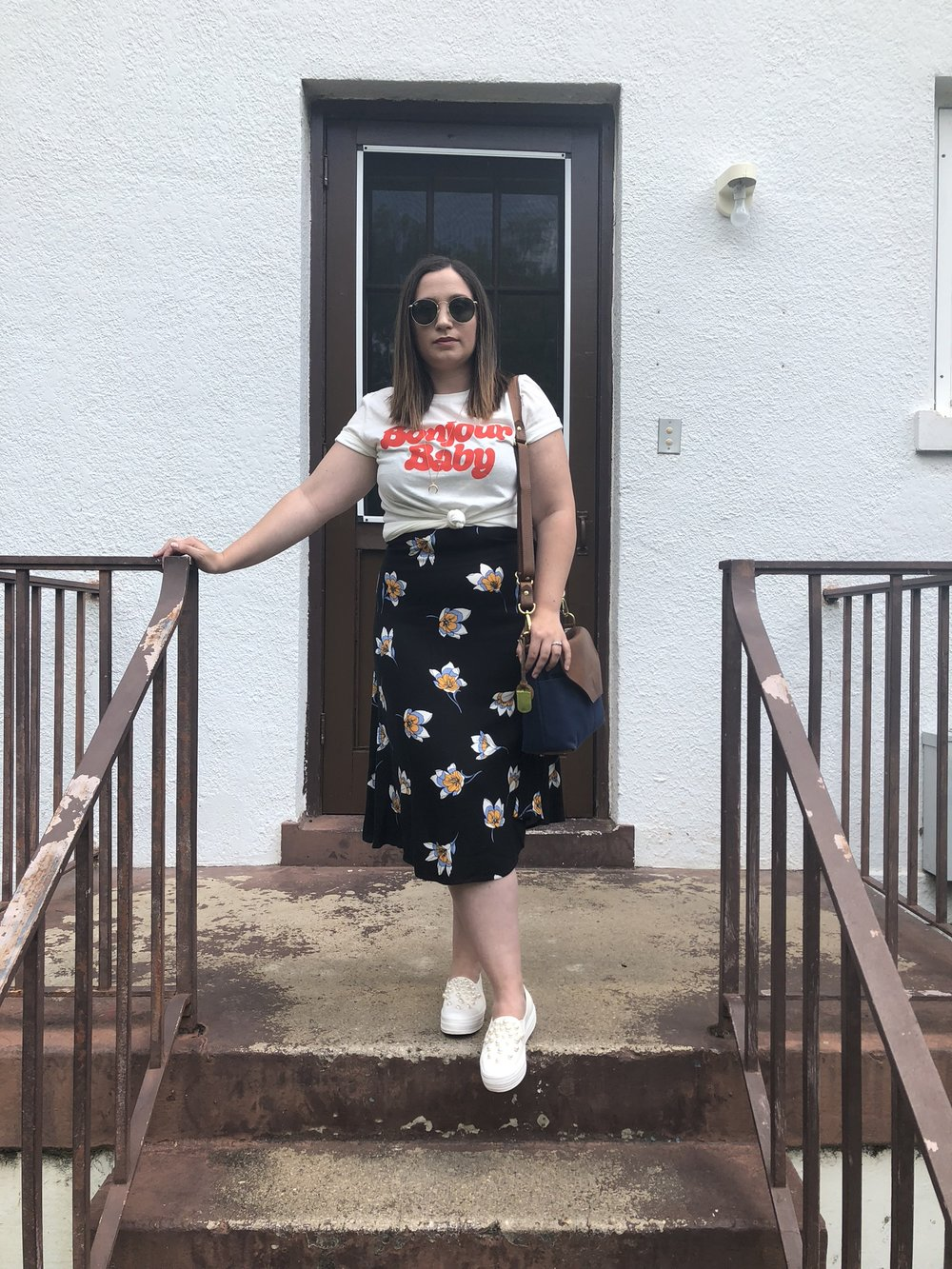 fashion blogger outfit, graphic t-shirt outfit idea, graphic tee layered with skirt, graphic tee layered over dress
