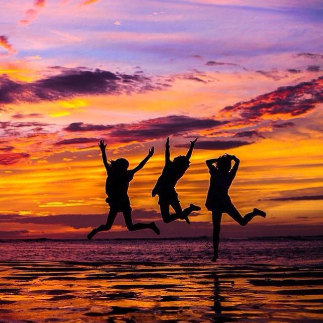 sisters sunset jump.jpg