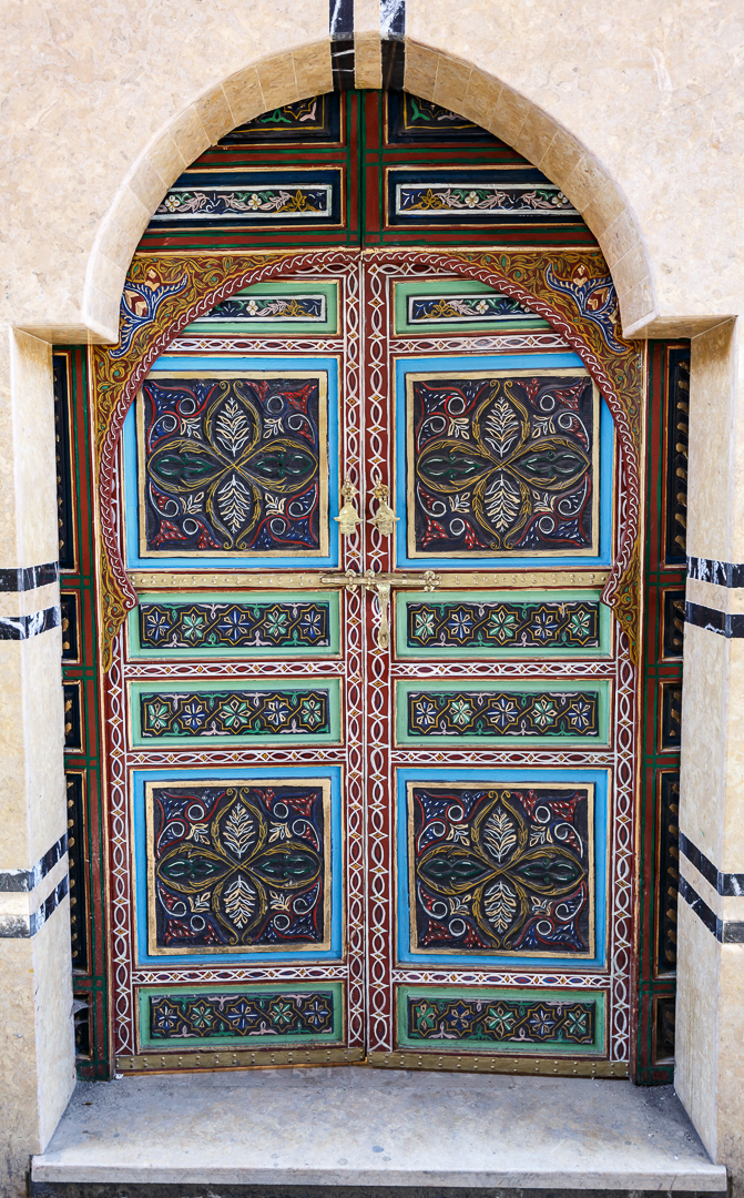 A welcoming spirit by the people of Marrakech is shown by decorating the doors of the houses with vibrant colors, intricate shapes, and attention to detail.