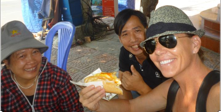 Sharing Bahn Mi with street Vendor Cat Ba Island/Halong Bay
