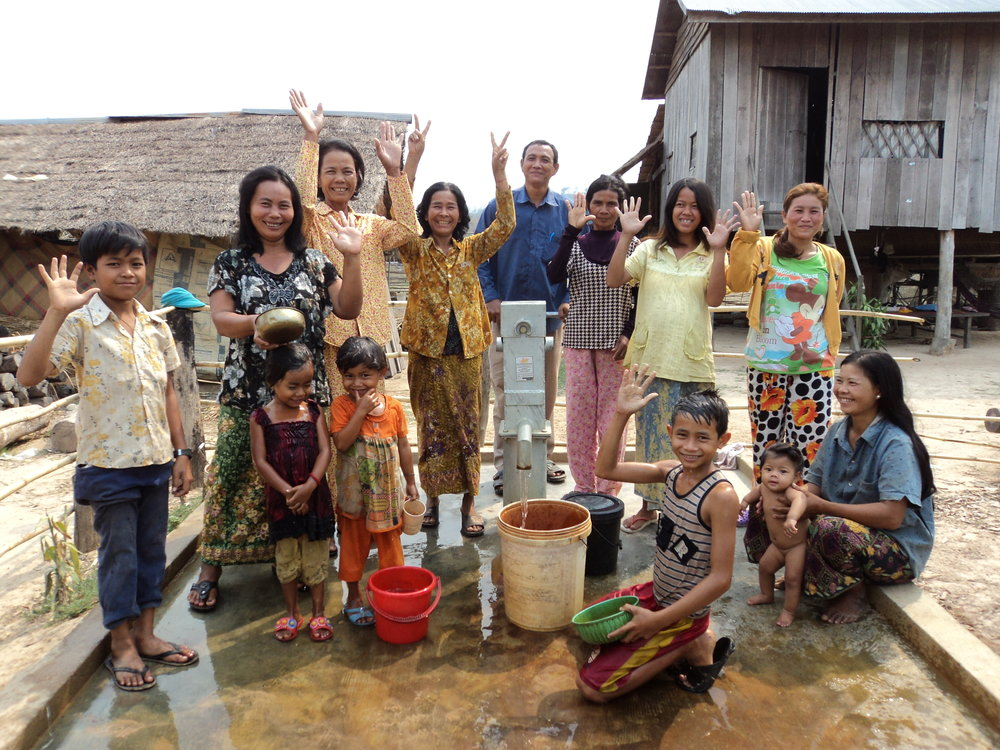 Rural residents celebrating a new water filtration system.