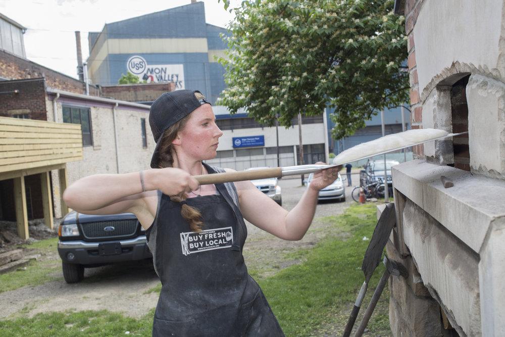 Shauna Kearns baking bread in the  Braddock Community Oven