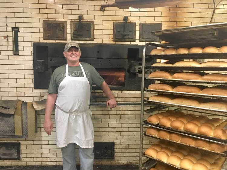 Alex Sanchioli in front of his oven in Bloomfield, Pittsburgh  Photo by Emeran Irby
