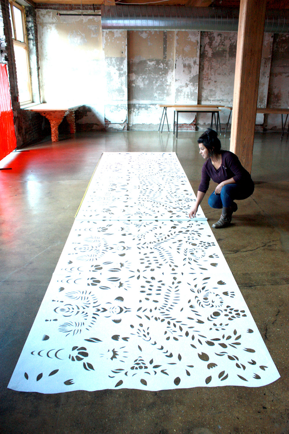 Karina Puente _ Artist Studio with Papel Picado 2.jpg