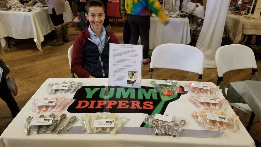 Chris selling Yummy Dippers at the 2018 Gifts That Give Back event.
