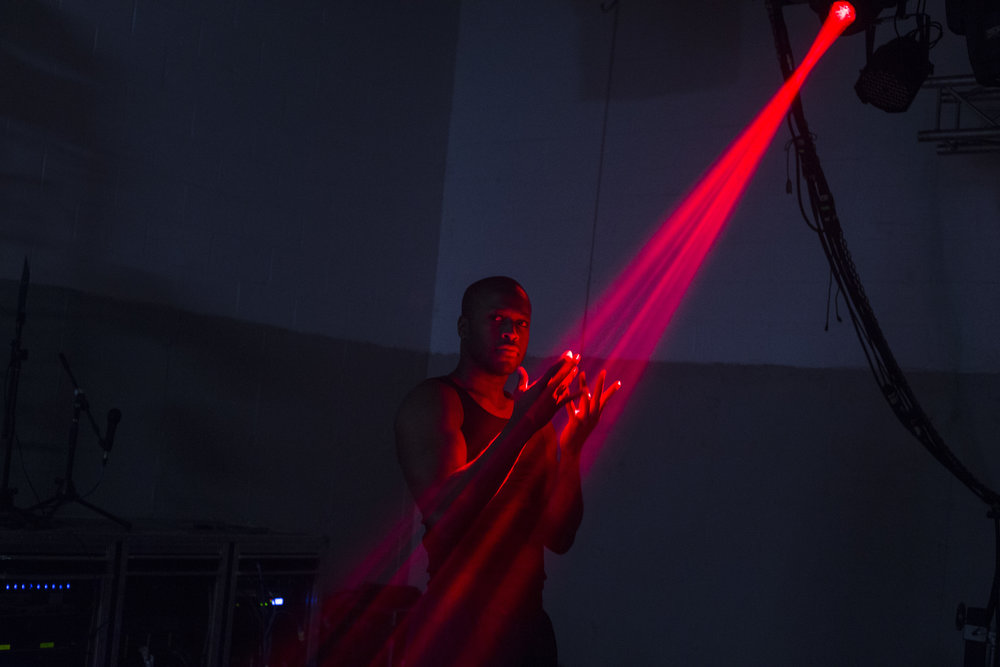 Valentino Smith, 26, of Detroit, Mich. plays with the stage lights during Magic Men's afternoon rehearsal at a small warehouse in Waterford Township on Thursday, March 23, 2017. The adult entertainment group has been touring for roughly two years and plans to visit over 100 cities for their 2017 tour, beginning in South Dakota. For The New York Times.