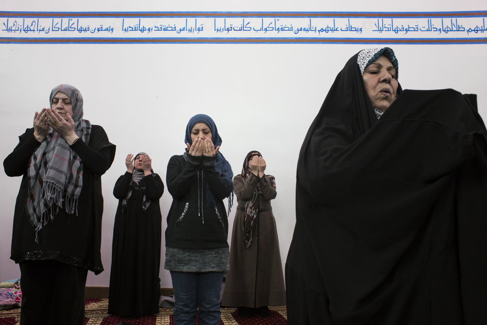 Members of the congregation lift their hands in prayer during a noon service at the Az-Zahra Islamic Center in Detroit, Mich., on Friday, March 4, 2016. Az-Zahra's imam, a prayer leader, Hassan Qazwini, used the service as an opportunity to discuss voting and his view of Republican Presidential Candidate Donald Trump, who he said he believes is unfit to be president.