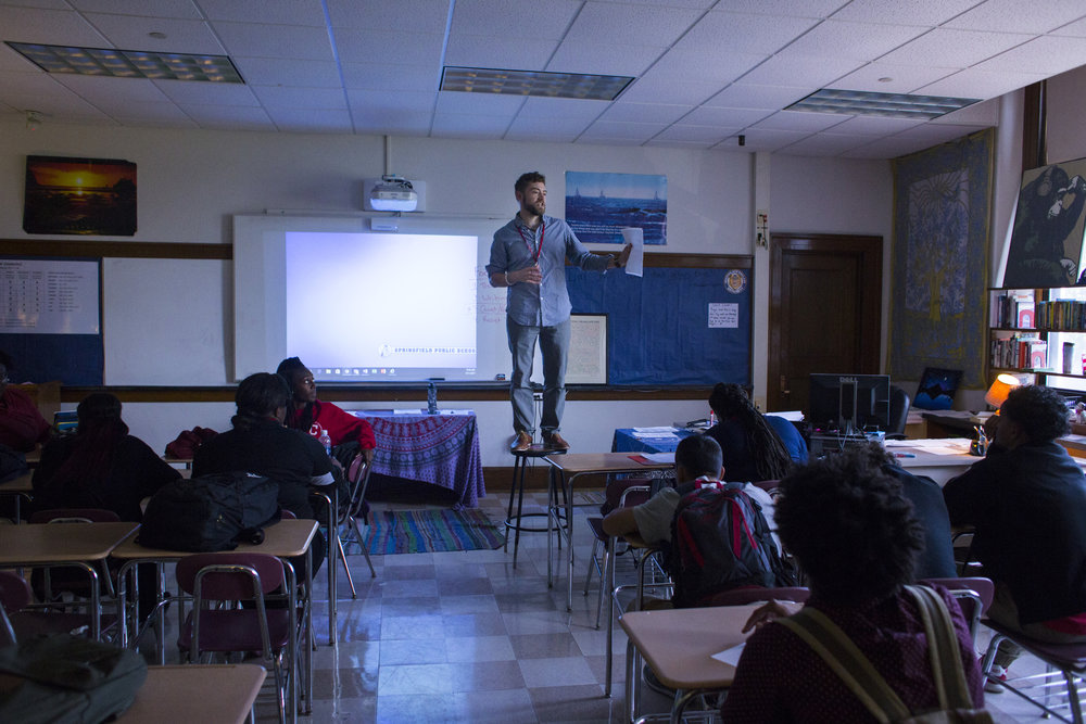 Brian Damboise, an English and Journalism teacher at the High School of Commerce, stands on a stool in order to get the attention of his students at the beginning of their class in Springfield, Mass., on Monday, September, 11, 2017.