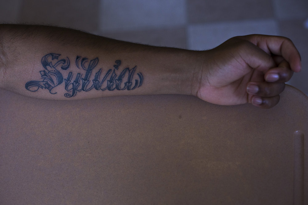 "Vdremus Covington, 18, shows his new tattoo dedicated to his mother during his Journalism class at the High School of Commerce in Springfield, Mass., on Monday, September, 11, 2017. ""She's always looking out for me...she'll be there for me when I need her to,"" Covington said."