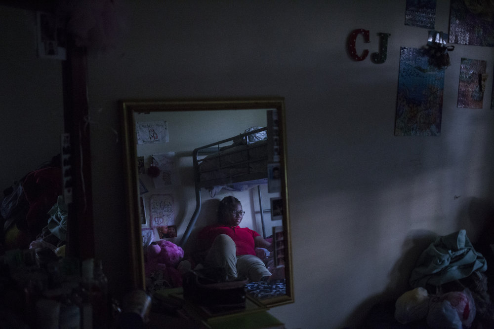 Tre'ana Taylor, 17, in her room, which she shares with her sister and niece, at her home in Springfield, Mass., on Monday, September, 11, 2017.  At the age of 15, Taylor faced both a pregnancy and the sub-sequential loss of her son, CJ, when he was born prematurely. She has high hopes of being a mother again once she's completed her schooling to become an OBGYN.