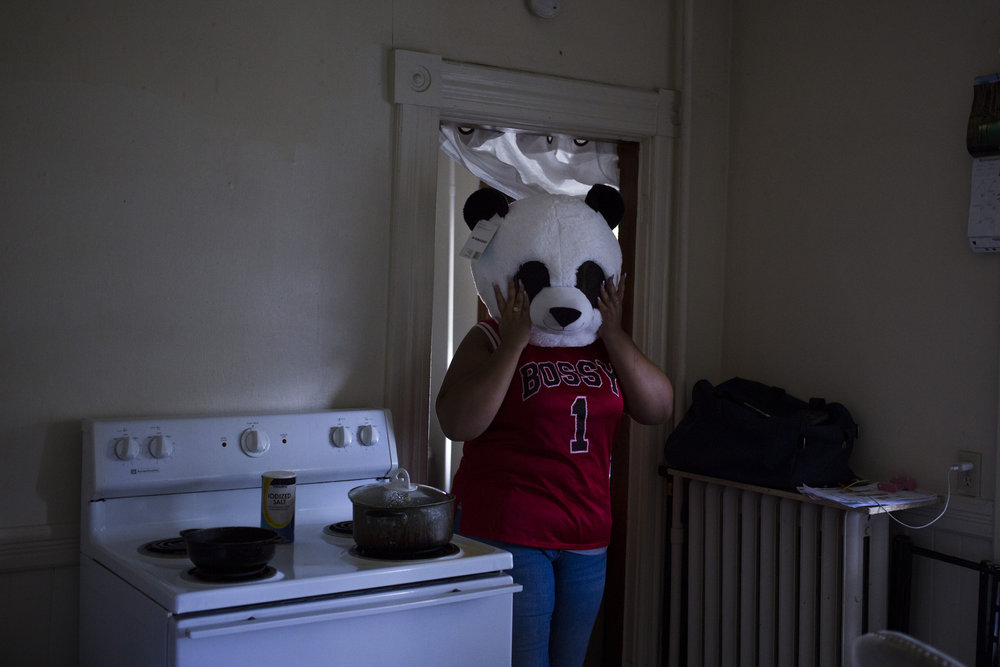 Destiny Montez, 17, shows her panda bear costume in the kitchen of her home in Springfield, Mass., on Saturday, September, 9, 2017.