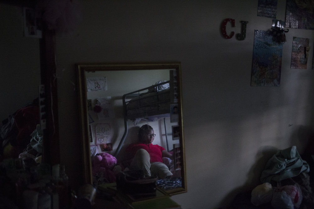 Tre'ana Taylor, 17, in her room, which she shares with her sister and niece, at her home in Springfield, Mass., on Monday, September, 11, 2017. At the age of 15, Taylor faced a pregnancy and then the sub-sequential death of her son, CJ, when he was born prematurely. She has high hopes of being a mother again once she's completed her schooling to become an OBGYN.
