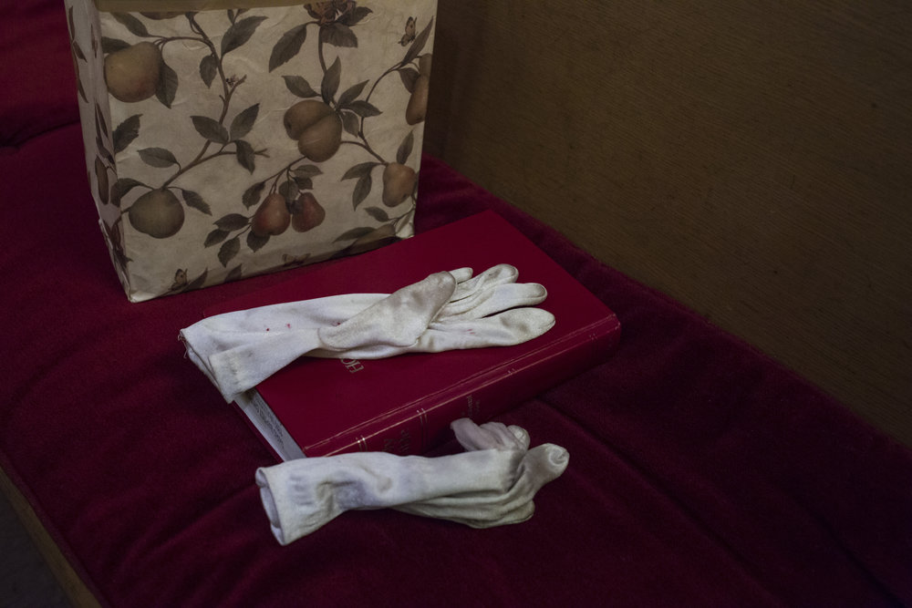 A pair of gloves rest on a bible during service at the Third Street Baptist Church in the Fillmore district of San Francisco, California., on Sunday, November 5, 2017.