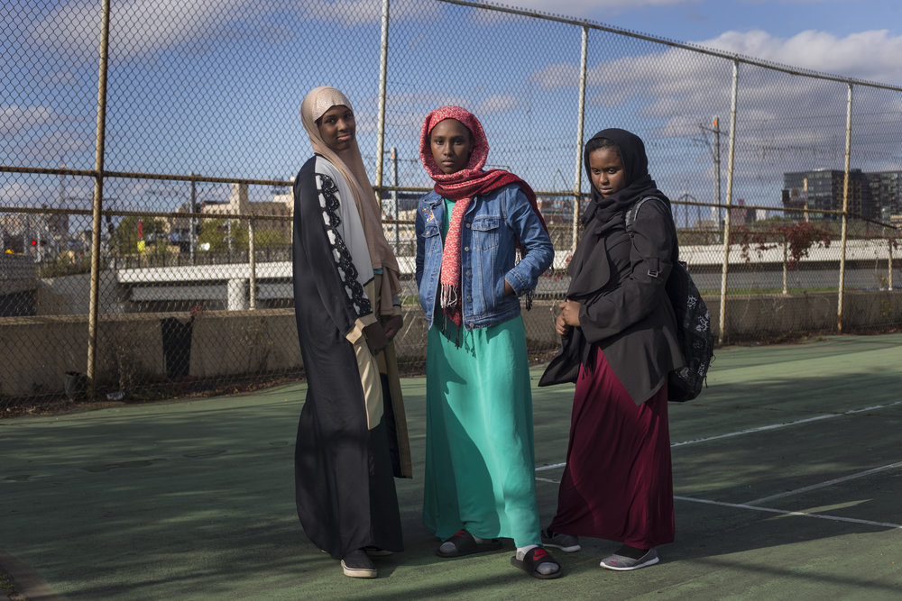 From left to right, Maryam Warsame, 13, Nada Tohu, 13, and Ikran Ibrahim, 12, outside of the Brian Coyle center in the Cedar Riverside neighborhood of Minneapolis, Minn., on Thursday, October 12, 2017. Minneapolis is home to the largest Somali-American population in the United States.