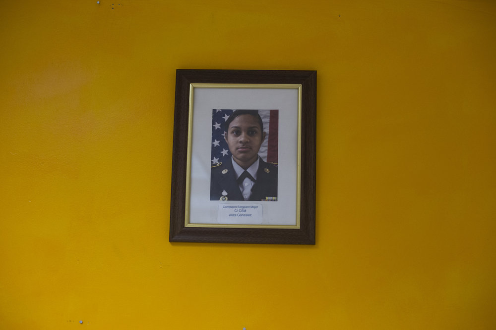 A single photograph featuring Command Sergeant Major Aliza Gonzalez hangs on the wall in a JROTC classroom in Springfield, Mass., on Monday, September, 11, 2017.