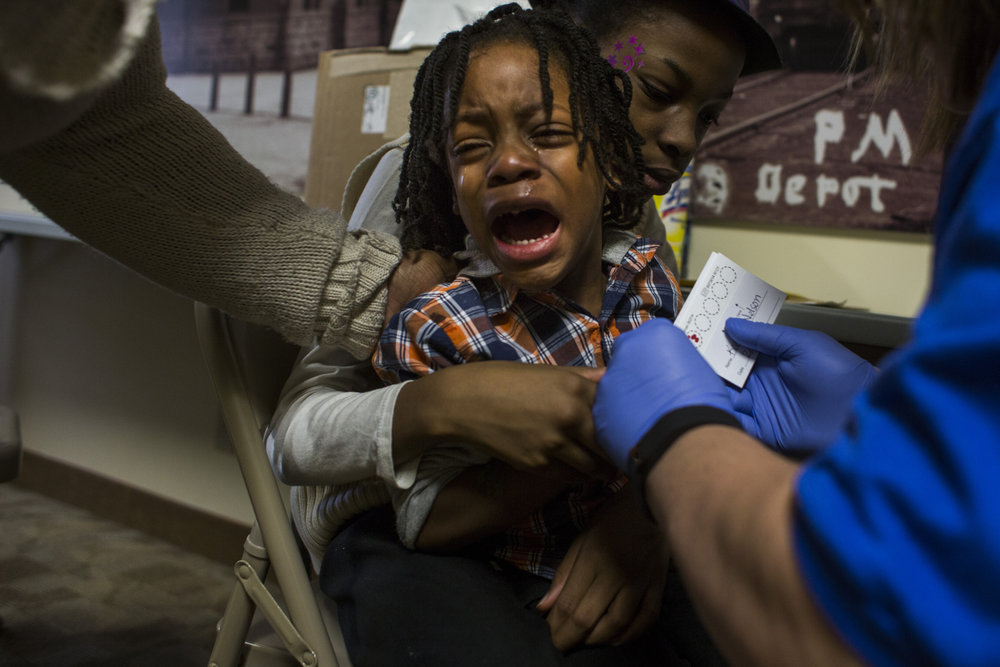 Keeghan Nelson, 4, of Flint, Mich., gets his blood lead levels tested at Carriage Town Ministries in Flint, Mich., on Thursday, February 4, 2016. Several blood lead level testing events have been put on in partnership with the Michigan State Health Department following the declaration for a state of emergency in the city.