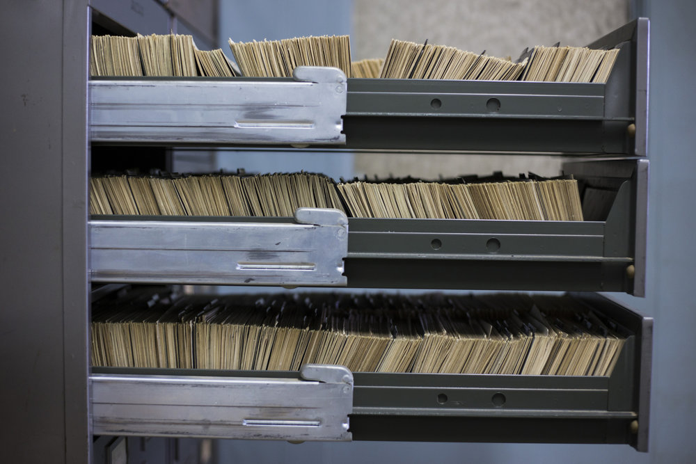 Hundreds of index cards, possessing the addresses of local water lines and whether or not they are made of lead, are stacked in one of the filing cabinets at the City of Flint Division of Water Service Center on February 11, 2016. There were roughly 50,000 cards in total, organized by street name, however, not all had complete information regarding the lead lines as they date back to the 1920's. In the Fall of 2015, when the presence of lead was first publicly announced to be in the tap water of residents, only a fourth of the cards were computerized leaving many community members in the dark about their own plumbing system.
