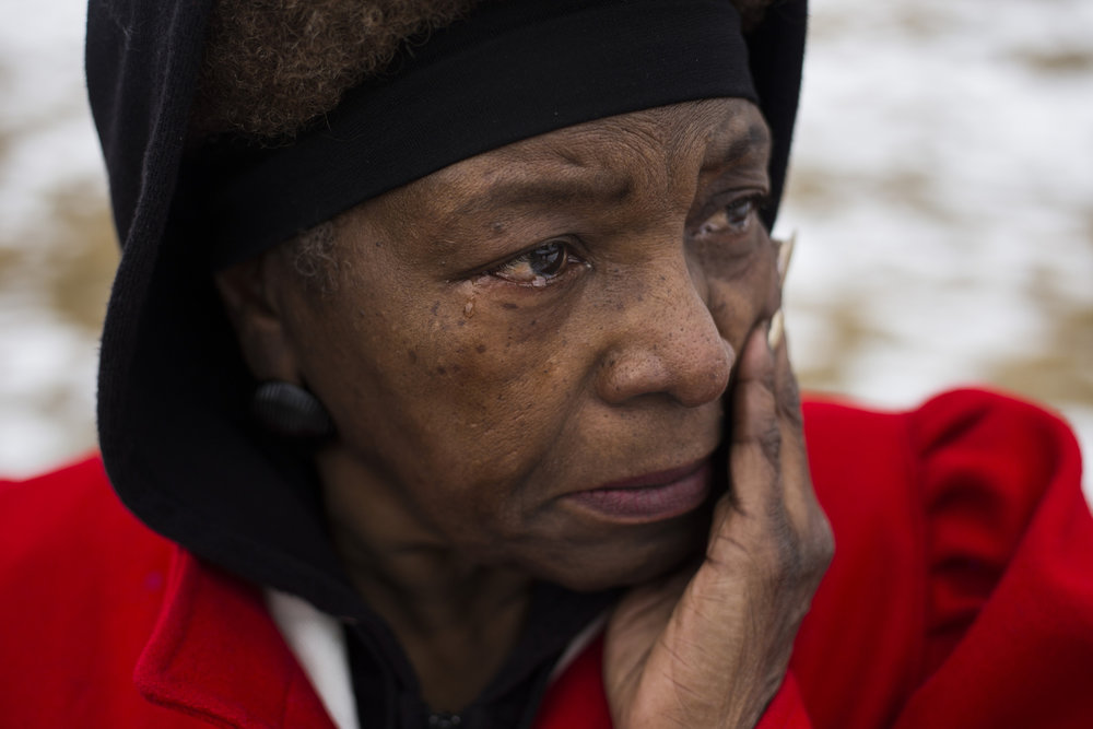 "Gail Morton, 64, of Flint, Mich., sobs as she watches protestors gather following a scheduled march with the Rev. Jesse Jackson that made it's way from the Metropolitan Baptist Tabernacle Church over a mile to the front of the the City of Flint Water Plant, on Friday, February 19, 2016. ""As a small child growing up you could almost see what our parents went through. We didn't have the rights. We didn't even have the rights to live in certain neighborhoods,"" Morton said. ""I am so proud today, I mean, I am really proud."""