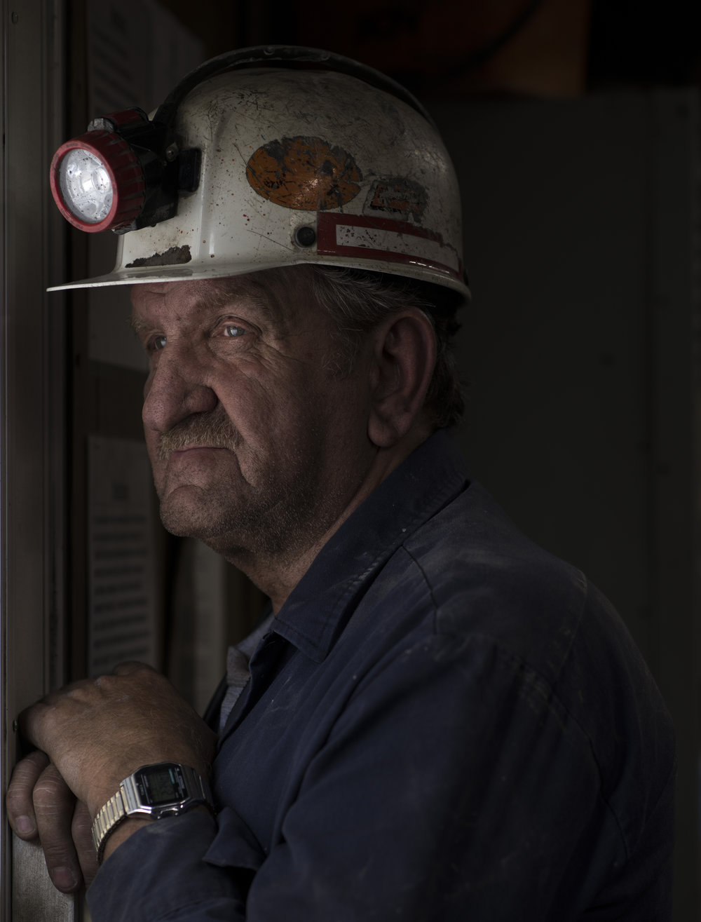 Superintendent David Gayhart, 61, of Dorton, Ky., patiently watches for the inspector and for his remaining miners to come out from underground at the office of Cheyenne Mining in Tram, Floyd County, Kentucky, on August 7, 2018. Gayhart has been a miner for roughly 41 years.