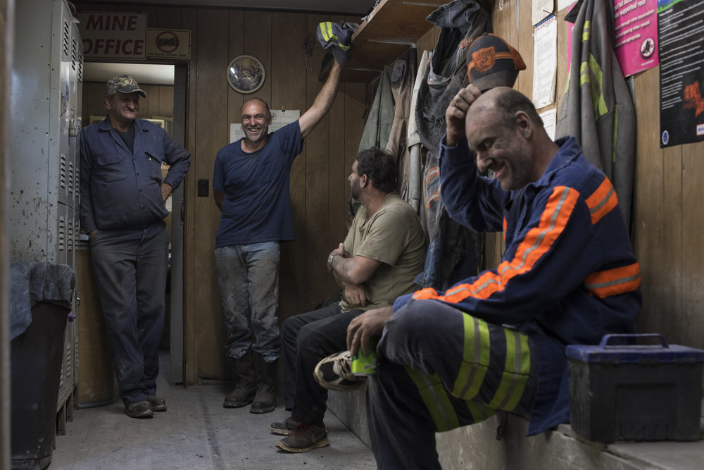From center to right, Steven Hicks, 50, Shane Hicks, 42, and Brian Hicks, 48, hang out with Superintendent David Gayhart, 61, far left, at the end of their shift at Cheyenne Mining in Tram, Floyd County, Kentucky, on August 6, 2018. All three of the brothers work at the mine together and have been coal miners since the early 90's.