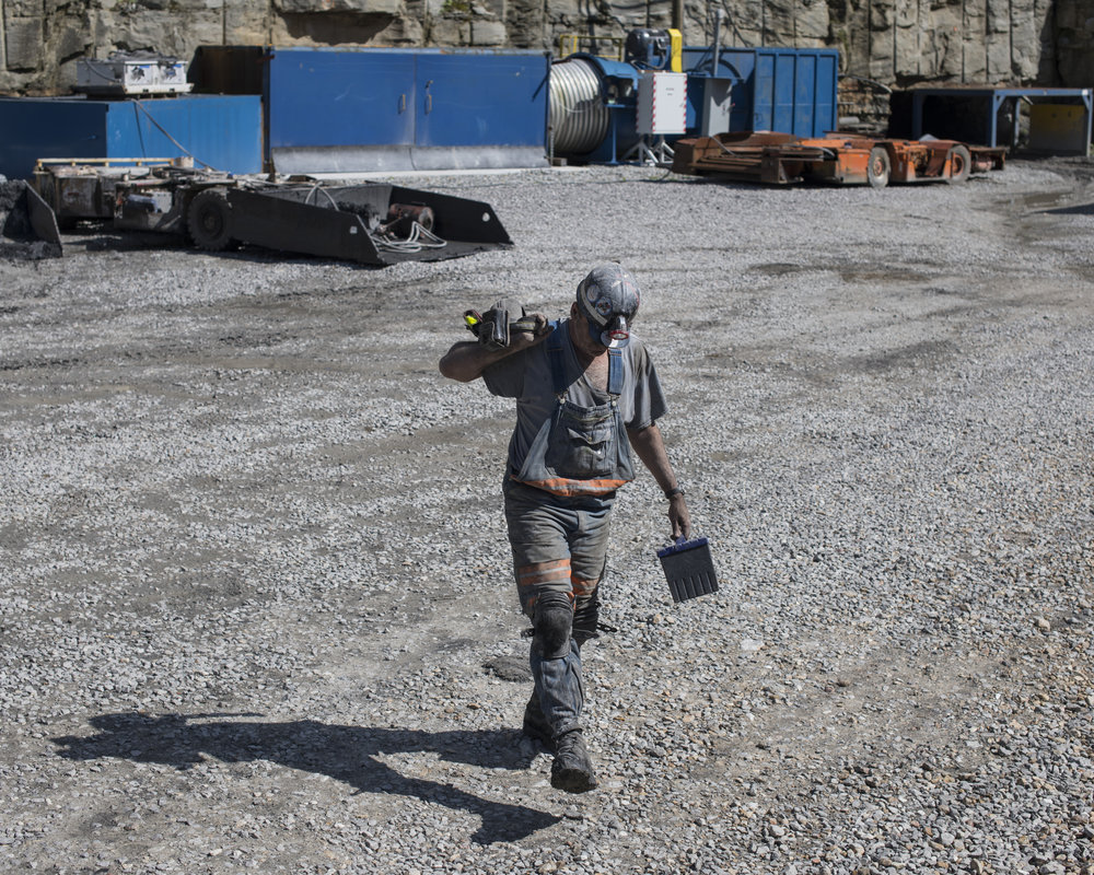 Brian Hicks, 48, comes out from underground after having to help overtime with repairs to equipment that went down while working at Cheyenne Enterprises Mining in Tram, Floyd County, Kentucky, on August 6, 2018. Hicks and three of his brothers work at the mine and have all been coal miners since the early 90's.