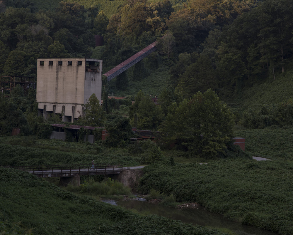 A man walks across a bridge at the site of the old Elk Horn Coal Company turned Inland Steel Company coal mine and preparation plant in Price, Floyd County, Kentucky, on August 14, 2018. The company helped build the town of Wheelwright and closed in the 1970�s. Wheelwright�s peak population was over 2,000 in the1950�s and as of 2016 is estimated to be under 700 according to the U.S. Census.