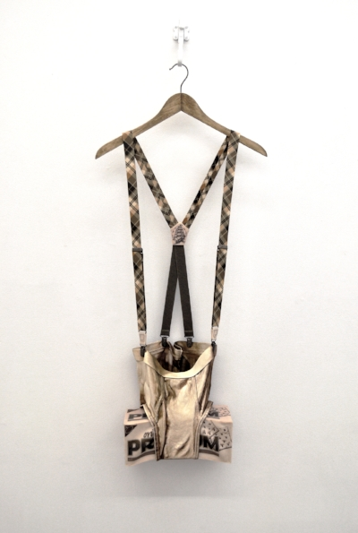Spreizhosen , 2017 oil on canvas, oil on fabric, tattooed rubber silicon, plastic, hanger, iron hook, suspenders hardware, 18 x 42 inches / 46 x 107 cm
