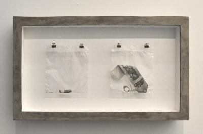 Stinky Platinum , 2014-2017 Graphite pencil on paper, plastic bag, nails, hooks, cork board , wood, and concrete 14 1/8 x 24 1/8 x 3 3⁄4 / 36 x 61 x 9.5 cm
