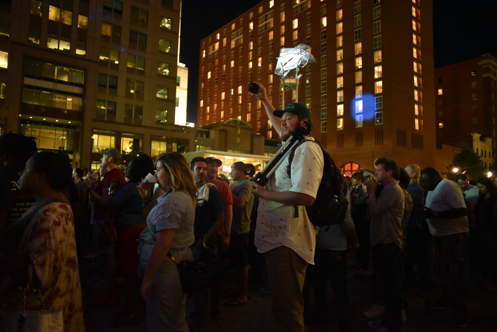 Shep Bryan  taking a 360° picture at a music festival in downtown Raleigh, NC.