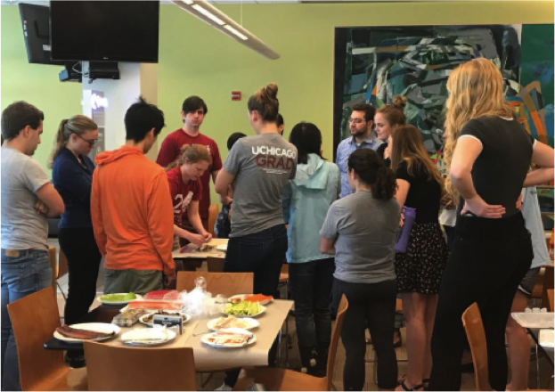 Students from Pritzker, Divinity, and Biological Sciences learn how to make sushi rolls